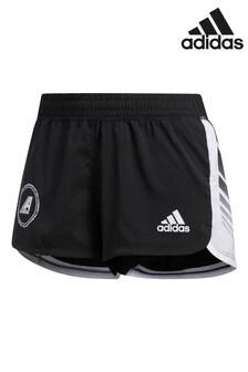 Черные текстильные шорты adidas с надписью