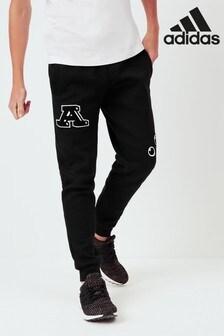 Čierne grafické tepláky adidas