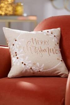 Coussin Merry Christmas avec couronne ornée de pompons