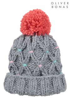 Oliver Bonas Criss Cross Stitch Coral Pom Knitted Beanie Hat