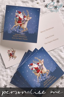 20 Pack Personalised Flying Santa Christmas Cards by Croft Designs