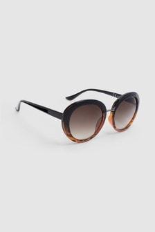 Gafas de sol redondas y glamurosas