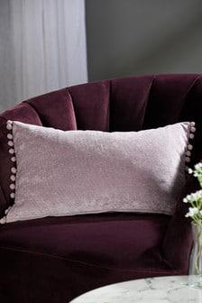 Мягкая велюровая подушка с помпонами