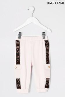 Розовые спортивные брюки с римскими цифрами River Island
