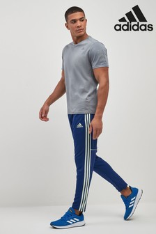 Granatowe spodnie dresowe adidas Unity
