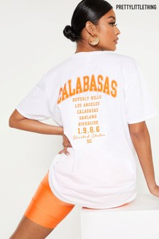 PrettyLittleThing White Calabasas 1986 Slogan Oversized T-Shirt