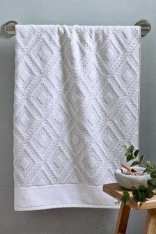 Luxuriöse Handtücher mit Geo-Design