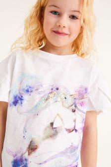 Flitrové tričko s volánikovými rukávmi a motívom jednorožca (3 – 16 rok.)