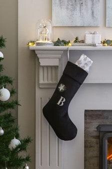 Черный носок для подарков с буквами алфавита