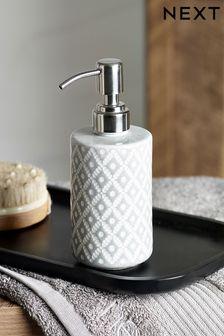 Szary dozownik do mydła, z geometrycznym wzorem