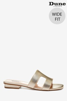 Zlaté kožené sandále na klinovom korkovom podpätku s remienkom do T a širokým strihom Dune London Koala