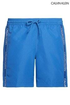 ملابس سباحة زرقاء وسط برباط للتضييق وشريط شعار CK من Calvin Klein