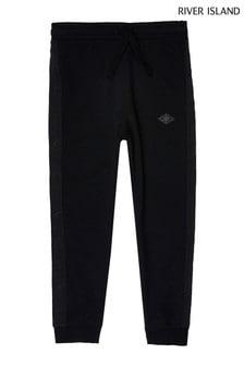 Pantalon de jogging River Island ado garçon fuselé en piqué noir