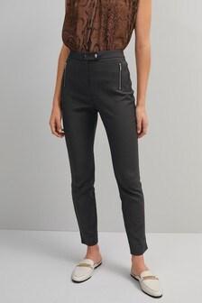 Зауженные брюки с молниями