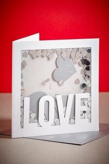 Valentinstagskarte mit Konfetti-Fenster