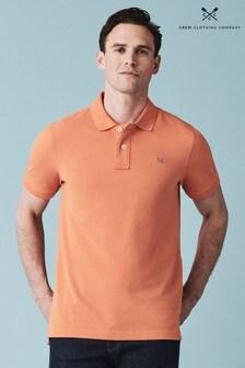 Polo clásico de piqué en naranja de Crew Clothing
