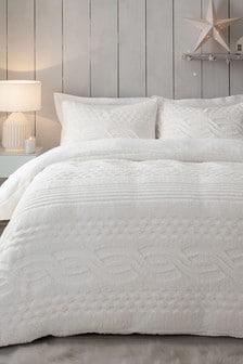 Kremowa, polarowa pościel z warkoczowym wzorem: poszewki na kołdrę i poduszki