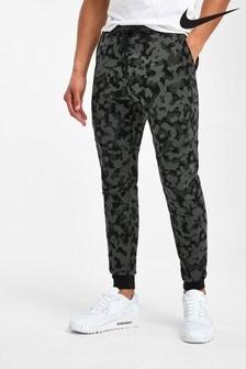 Флисовые спортивные штаны с камуфляжным принтом Nike Tech