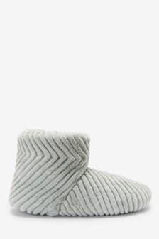 Pantoffelstiefel mit Fellimitat und Steppdesign