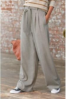 Spodnie w kratę o szerokiej nogawce
