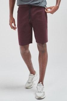 Jersey-Shorts mit Reißverschlusstaschen