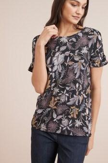 Блузка с расклешенными рукавами и отделкой