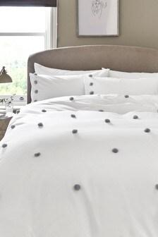 Zestaw puszystej pościeli z pomponami: poszwa na kołdrę i poszewki na poduszki