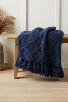 Темно-синее вязаное покрывало