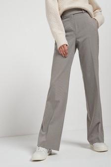 Строгие расклешенные брюки