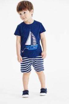 Completo maglietta con applicazioni e shorts (3 mesi - 7 anni)