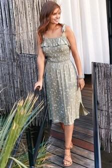 Sukienka warstwowa o średniej długości