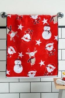 Красное полотенце с рисунком Санты и его друзей