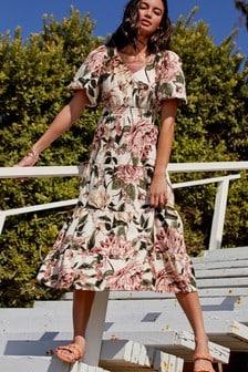 Трикотажное платье каскадного кроя с объемными рукавами