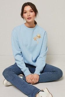 Suéter con adornos de palmeras