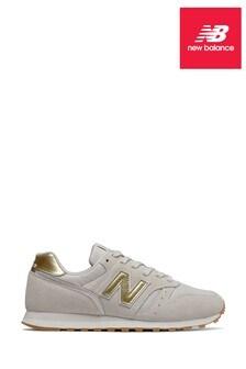 Белые кроссовки с золотистыми вставками New Balance 373