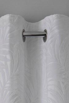 Белые шторы на подкладке с бархатным пальмовым узором и люверсами