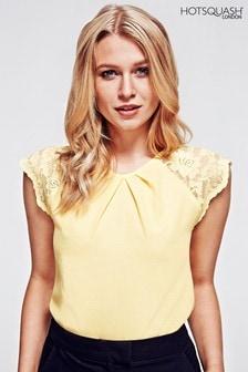 Žlutý krepový top HotSquash s krajkovými rukávy
