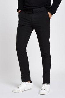 מכנסיים אלגנטיים שחורים בגזרת סקיני של River Island