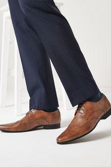 Классические туфли с фигурными вставками и перфорацией