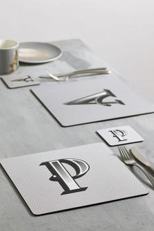 Podložky pod taniere a poháre s písmenami