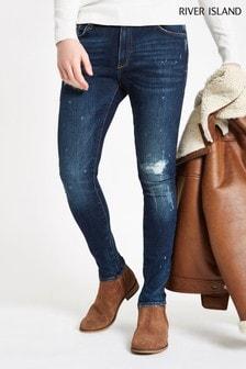 River Island - Donkerblauwe skinny jeans met opgespoten vervaageffect