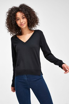 Suéter con cuello de pico