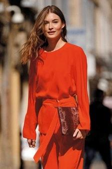 Блузка с завязывающимся поясом