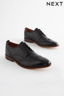 Zapatos Oxford de cuero con suela en contraste