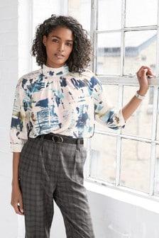 Блузка с пышными рукавами и воротником-стойкой