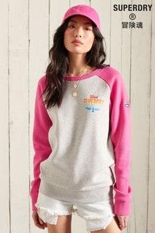 Superdry Sweatshirt mit verblasstem Regenbogendesign, Rundhalsausschnitt und Raglanärmeln