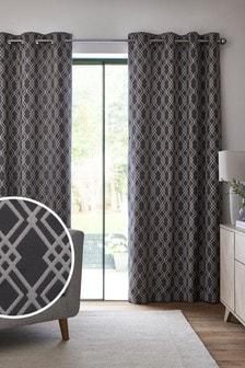 Жаккардовые шторы с геометрическим принтом в решетку и люверсами