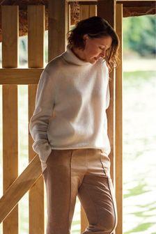 Sweter z golfem Emma Willis z wełny premium
