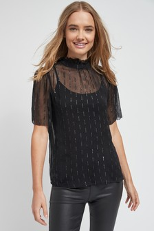 Блестящая блузка с воротником-стойкой и оборкой