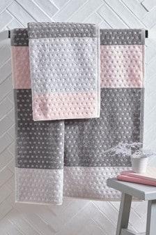 Roze/grijs gestreepte handdoek